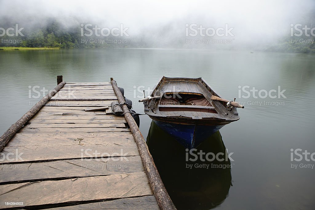 Little fisherman's boat tied to the pier royalty-free stock photo