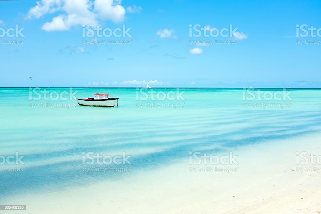 Little fishing boat in the caribbean sea on Aruba island stock photo