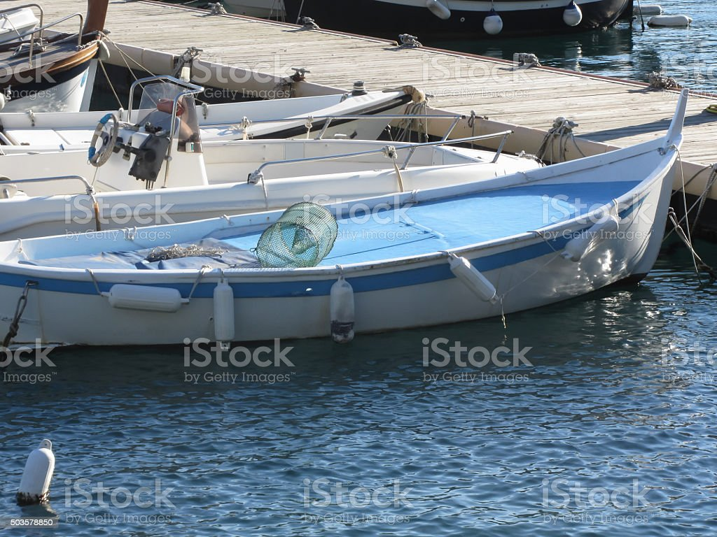 Little fishing boats anchored in a village port stock photo