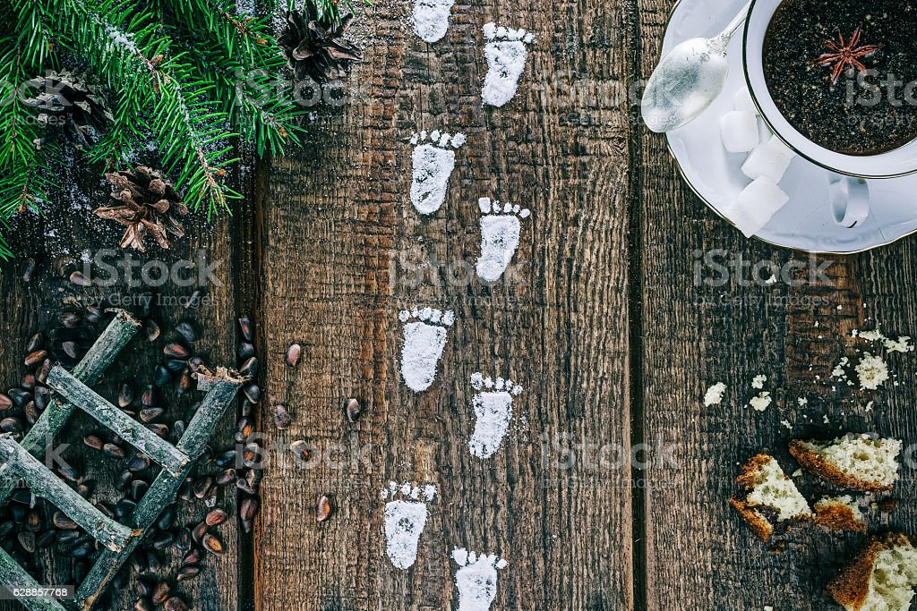 Little footprints on the table stock photo
