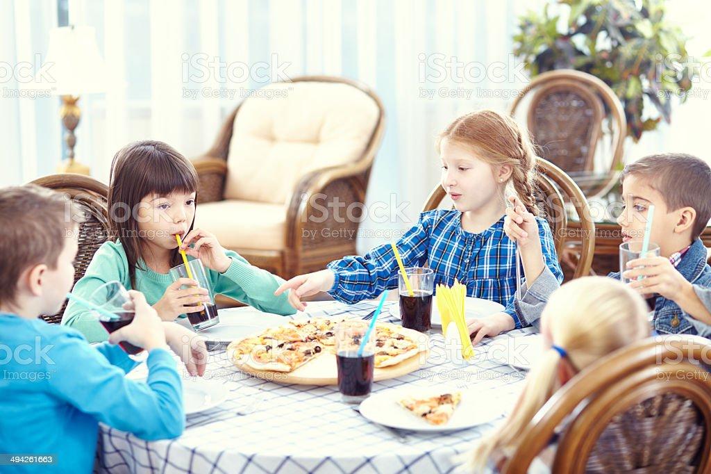 Little friends' dinner stock photo