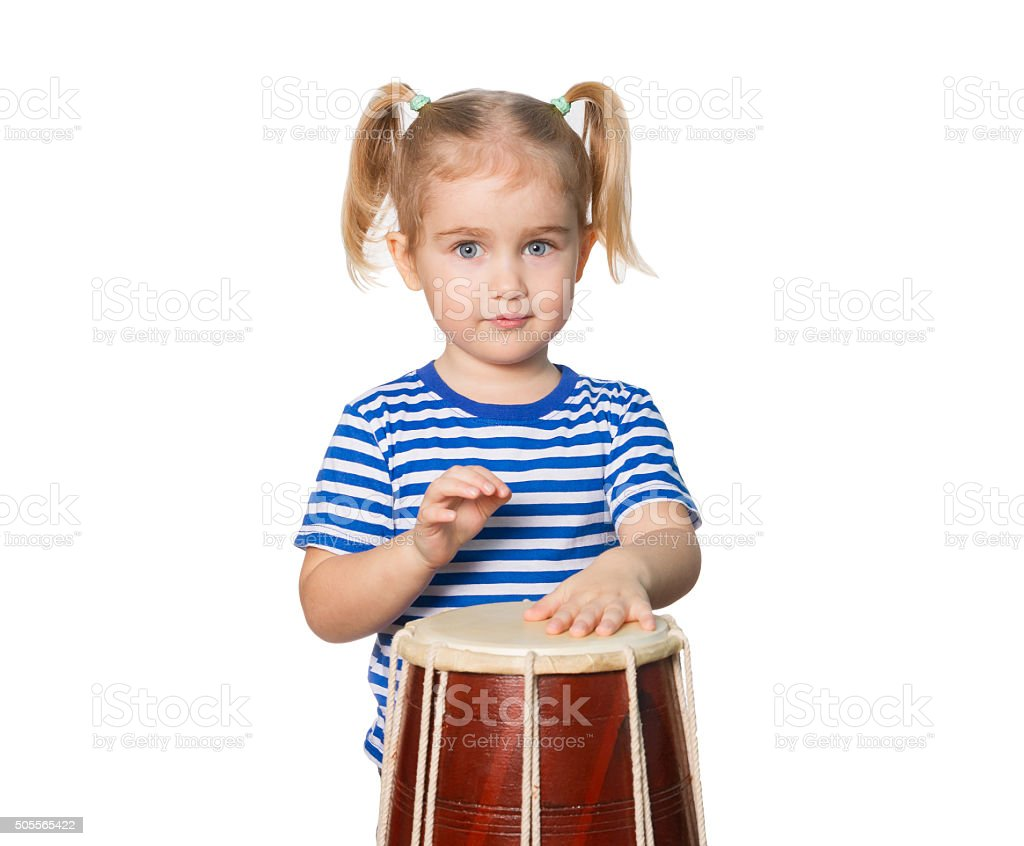 Little Funny girl  play drum. stock photo