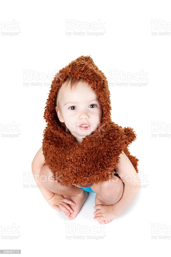 Little funny Neanderthal boy in a suit stock photo