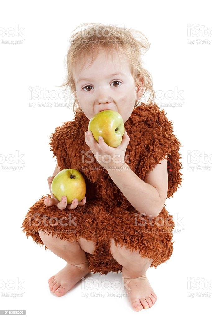 Little funny Neanderthal boy in a suit with grubby face. stock photo
