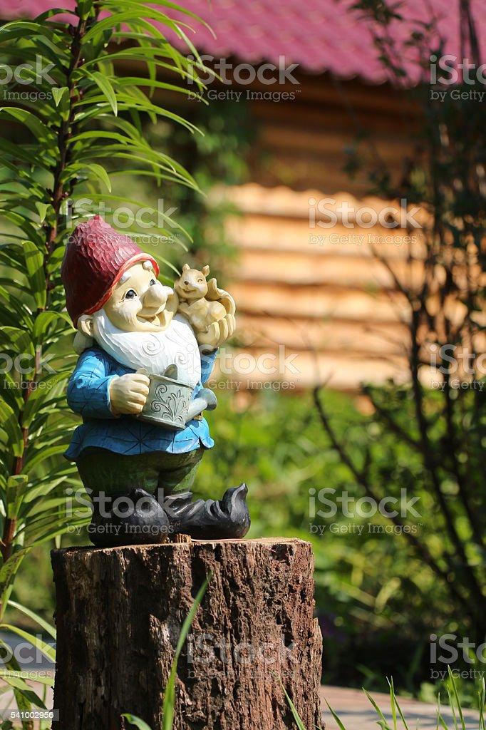 Little garden gnome figurine stock photo