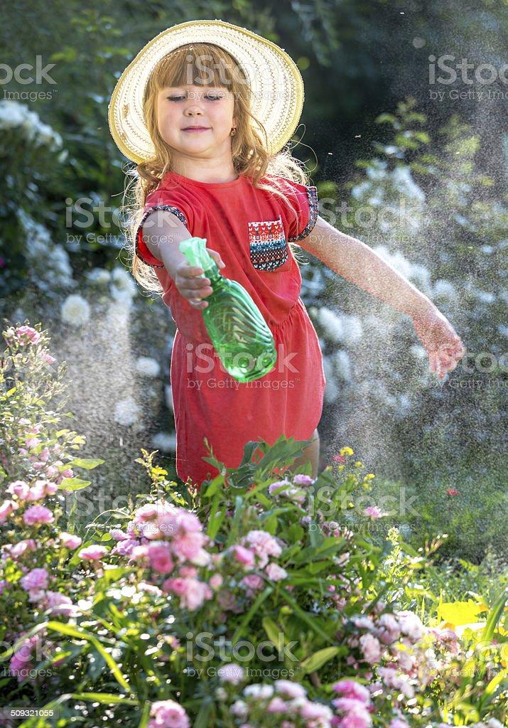 Little gardener on flowerbed royalty-free stock photo