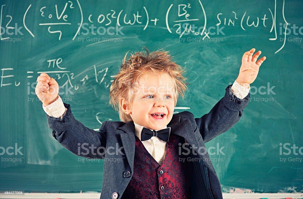 Little genius solving mathematical equation stock photo
