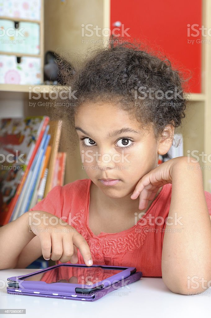 Little Girl, 7 Years Old, Using Digital Graphic Tablet royalty-free stock photo