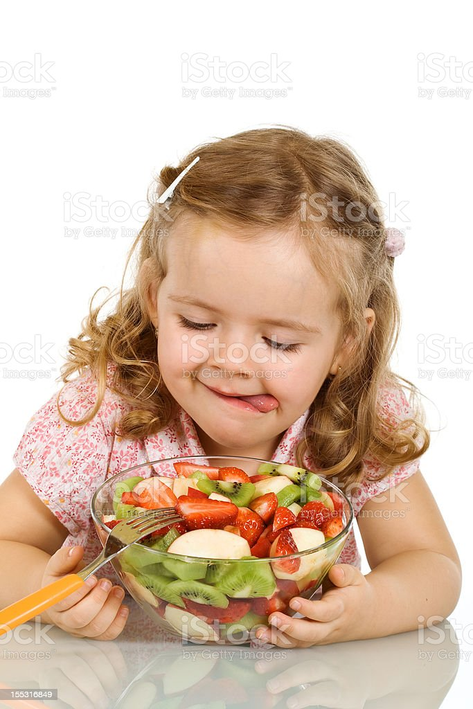 Little girl about to taste the fruit salad royalty-free stock photo