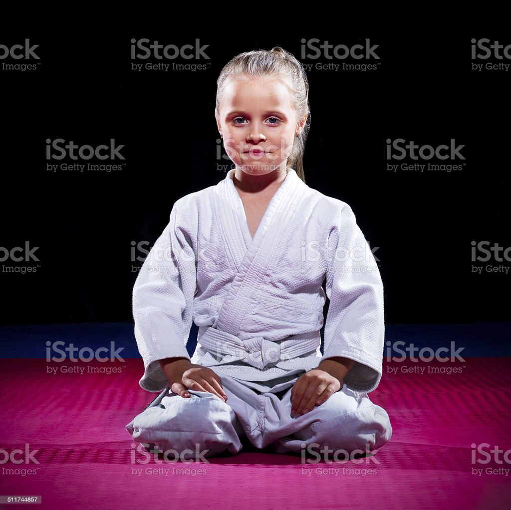 Little girl aikido fighter stock photo