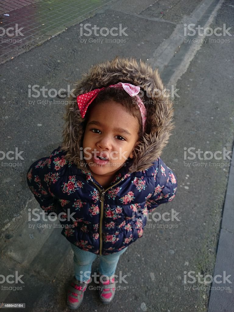 Little girl alone in the street stock photo