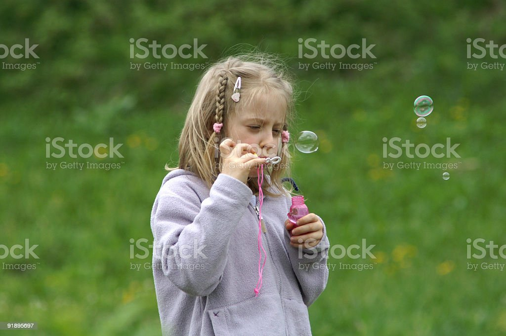 Little girl and a bubbles royalty-free stock photo