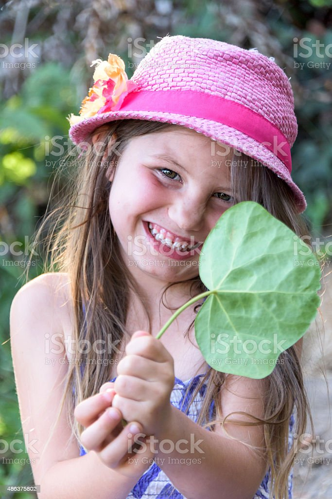 Little girl and a leaf stock photo