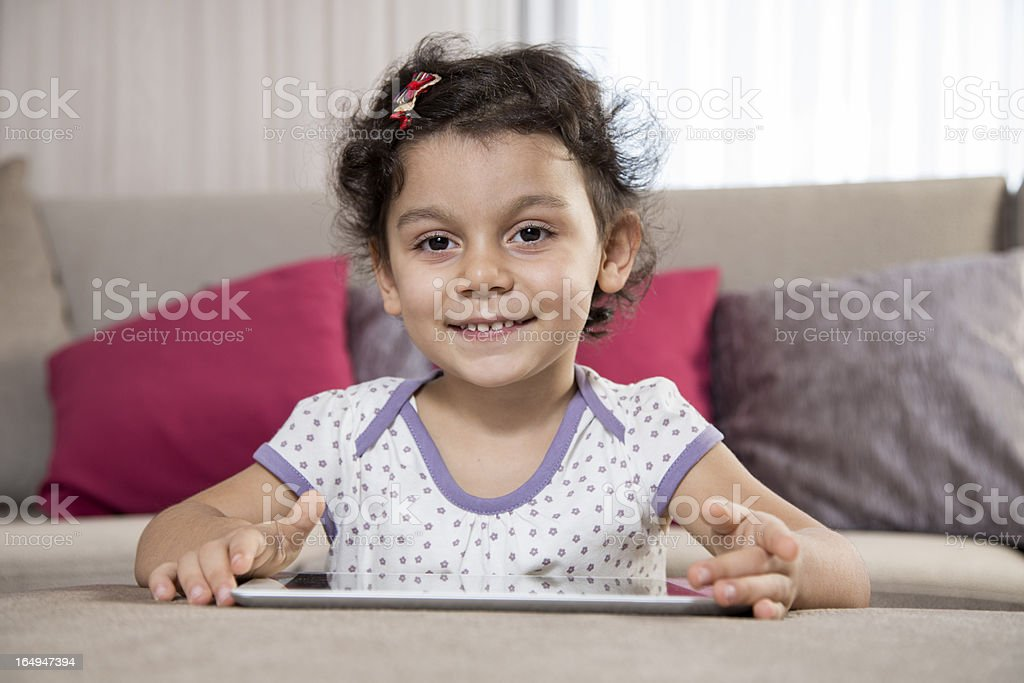 Little girl and a tablet royalty-free stock photo