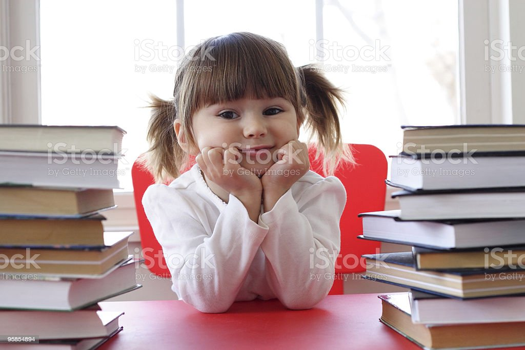 Little  girl and books for reading stock photo