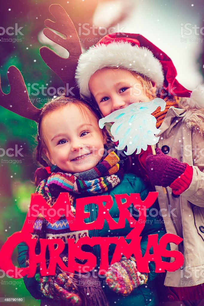 Little girl and boy in Xmas stock photo