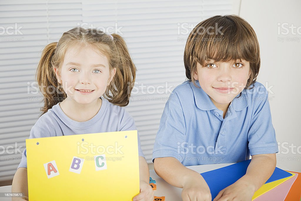 Little Girl and Boy Learning royalty-free stock photo