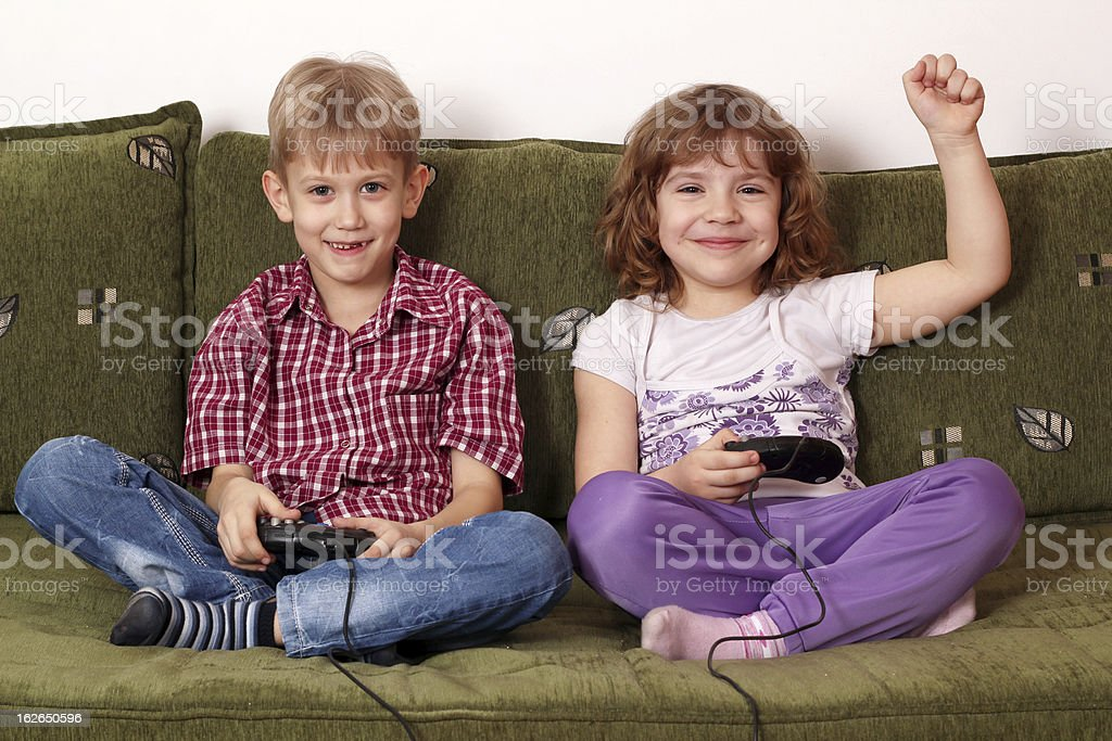 little girl and boy play video game royalty-free stock photo