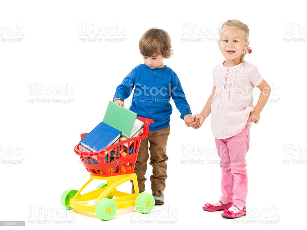 Little Girl And Boy Posing With Shopping Cart stock photo