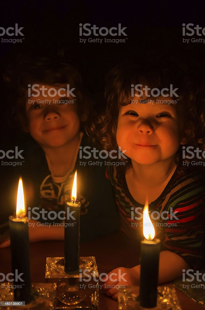 Little girl and boy with candles stock photo