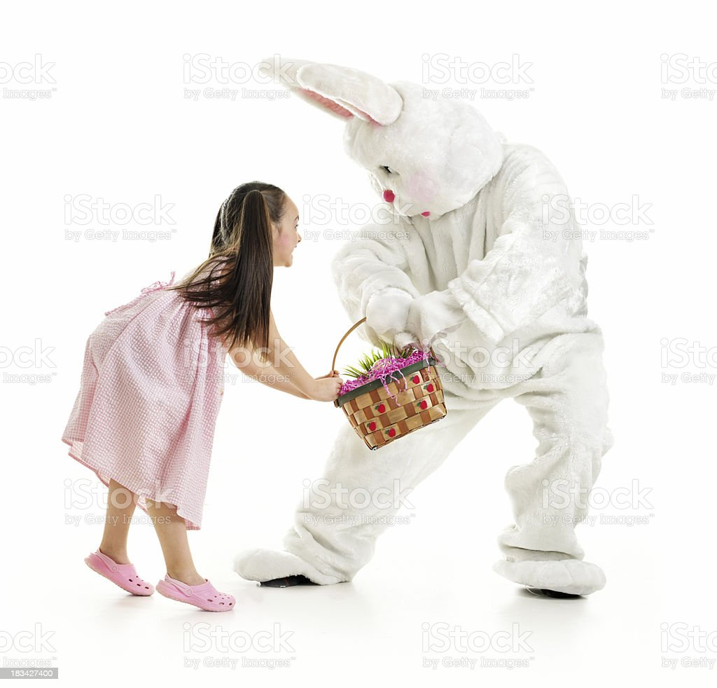 Little girl and Bunny fighting royalty-free stock photo