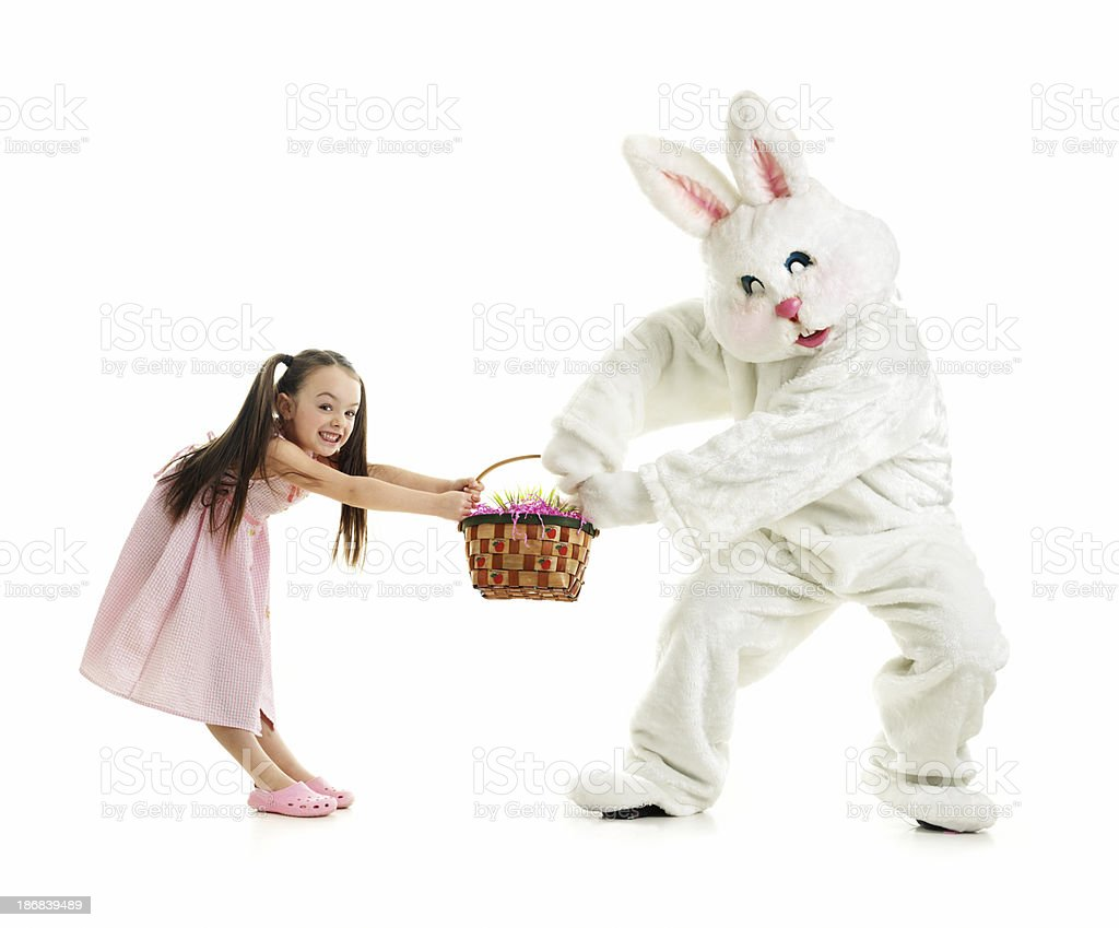 Little girl and Bunny fighting stock photo