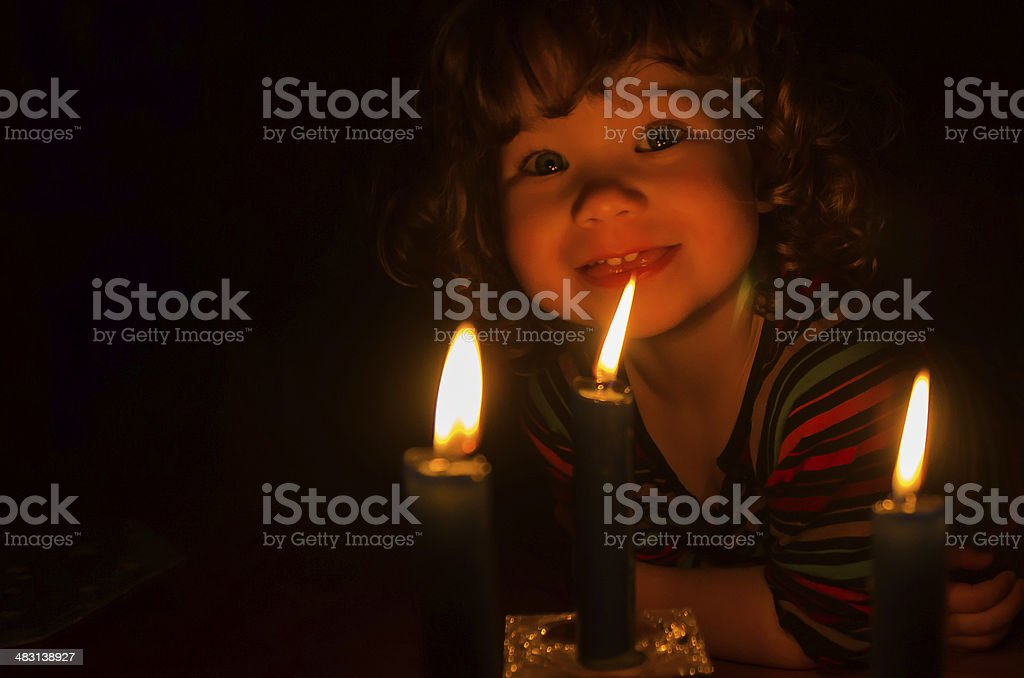 Little girl and candles stock photo