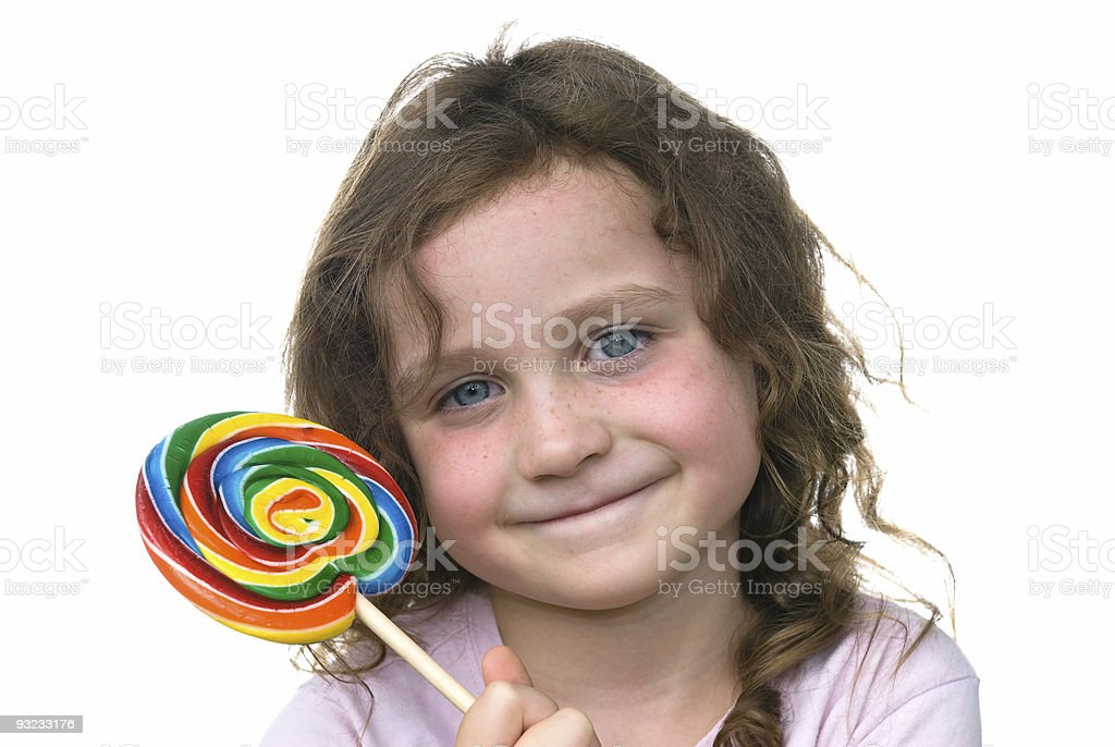 Little girl and candy pin wheel sucker royalty-free stock photo