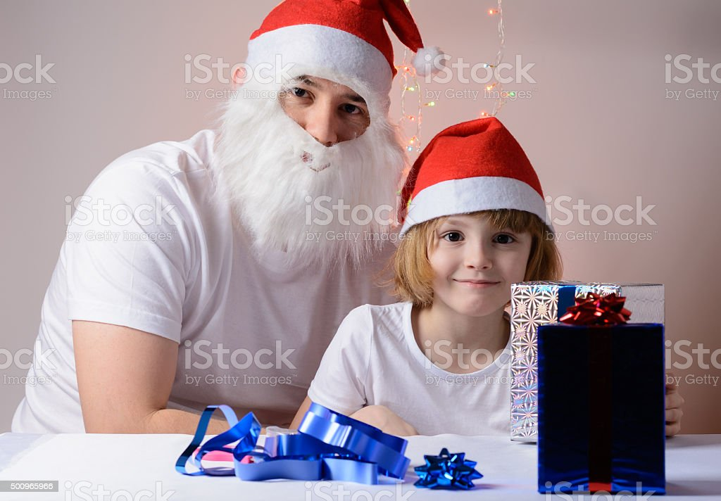 Little girl and father Christmas gift packs stock photo