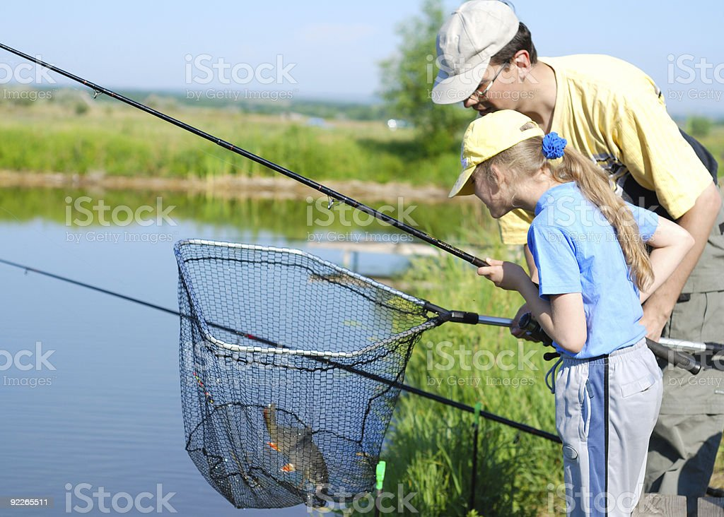 Little girl and father fishing royalty-free stock photo