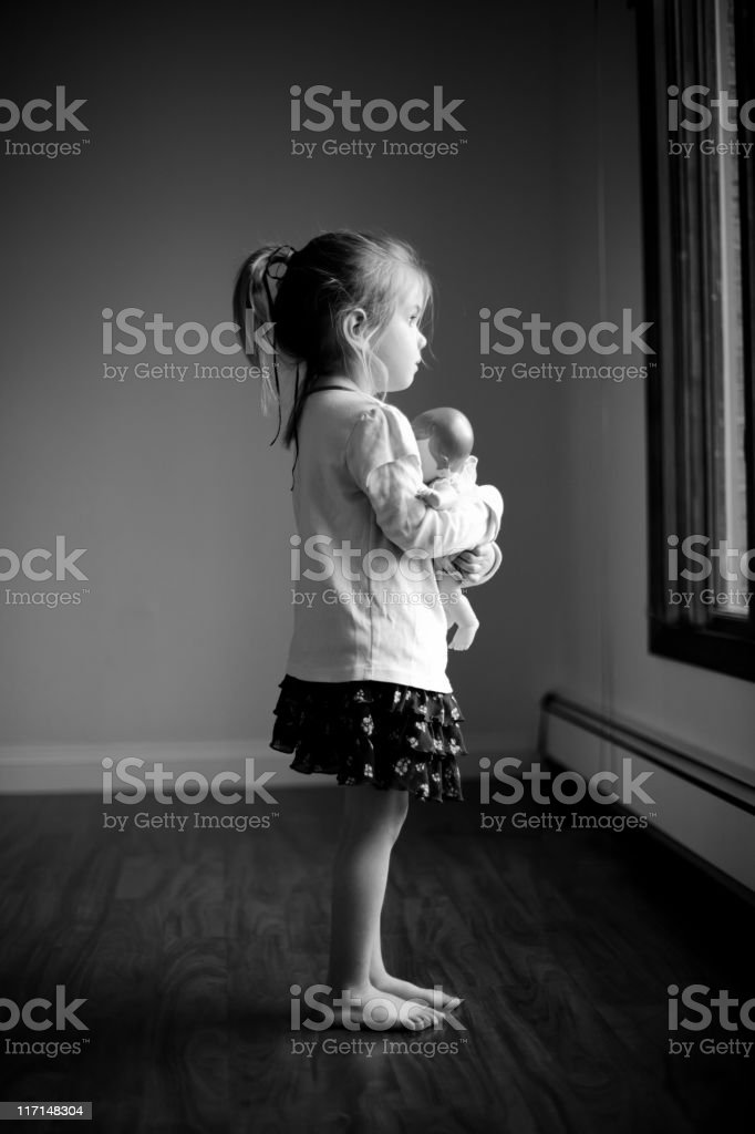 Little Girl and her Baby stock photo