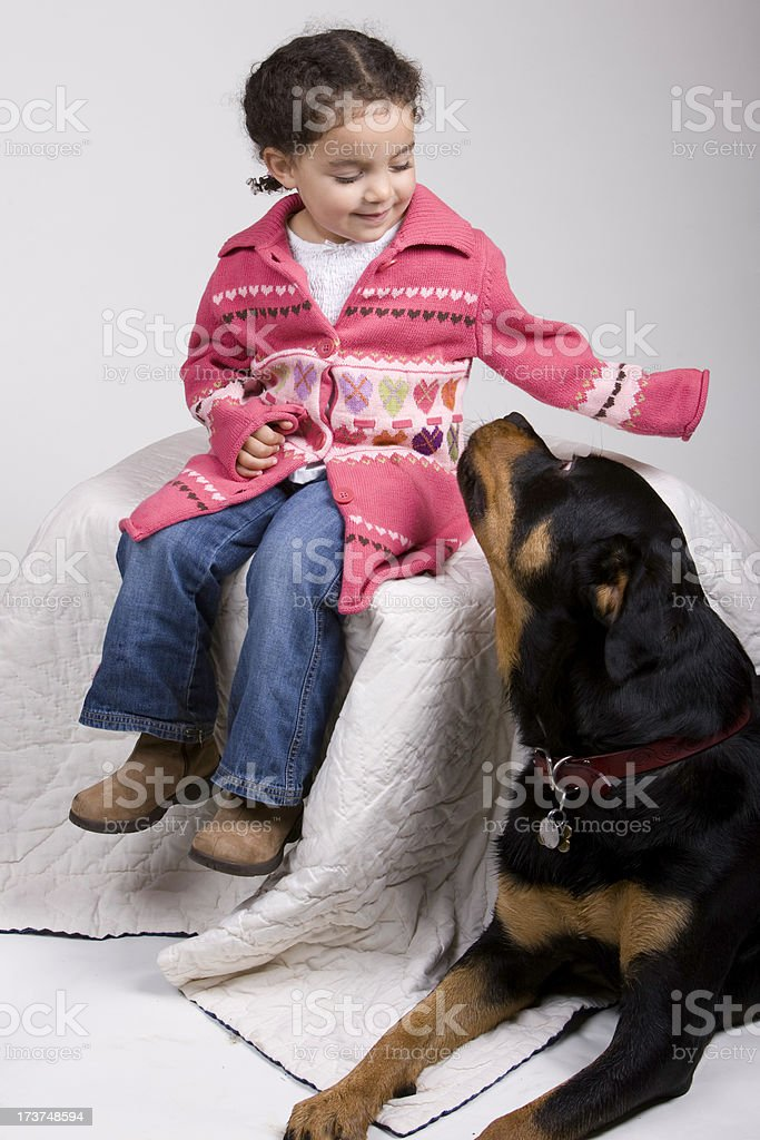 Little Girl and her Big Dog (Rottweiller) royalty-free stock photo