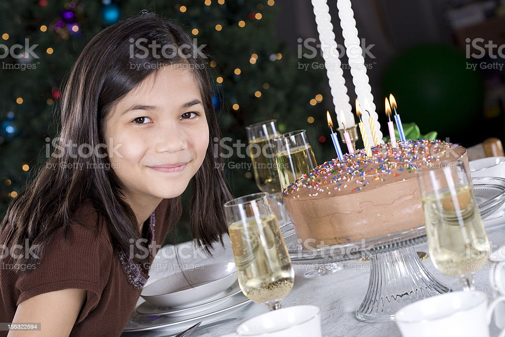 Little girl and her birthday cake candles royalty-free stock photo