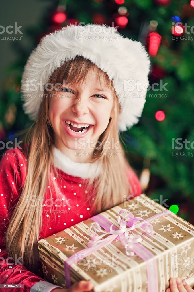Little girl and her christmas gift stock photo