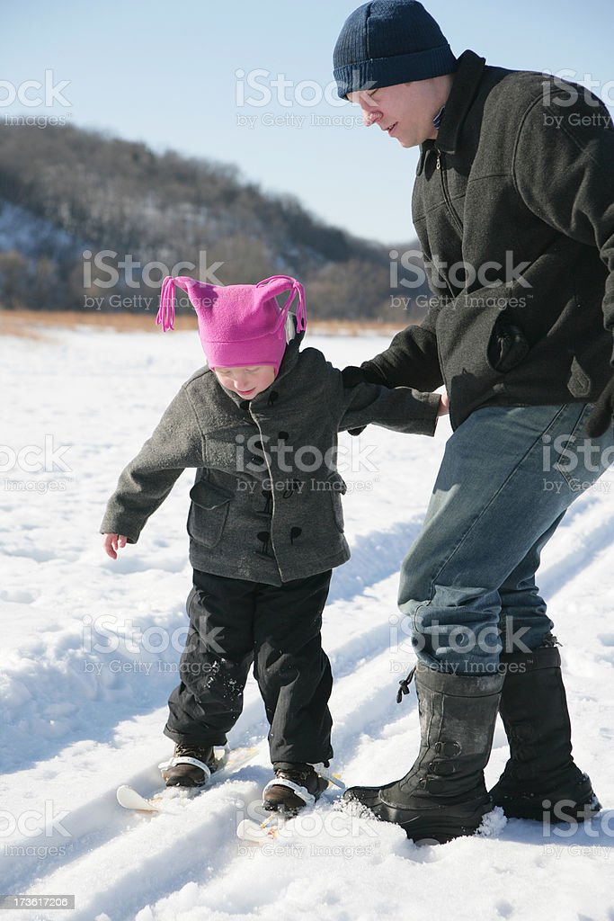 Little Girl and Her Father Cross Country Skiing royalty-free stock photo