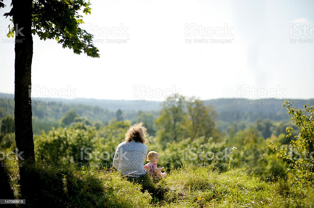 Little girl and her father on the edge of cliff royalty-free stock photo