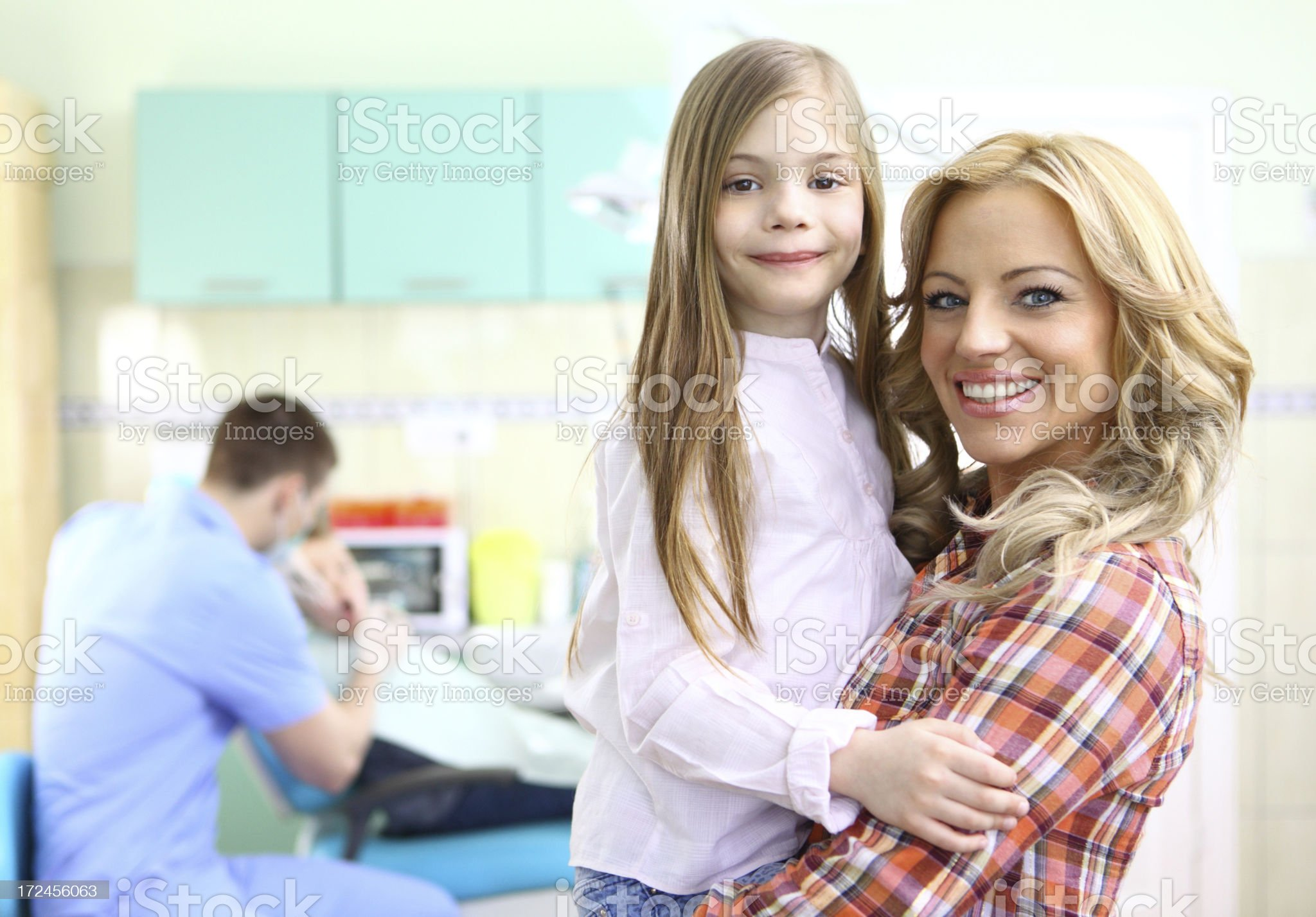 Little girl and her mother at dentist. royalty-free stock photo