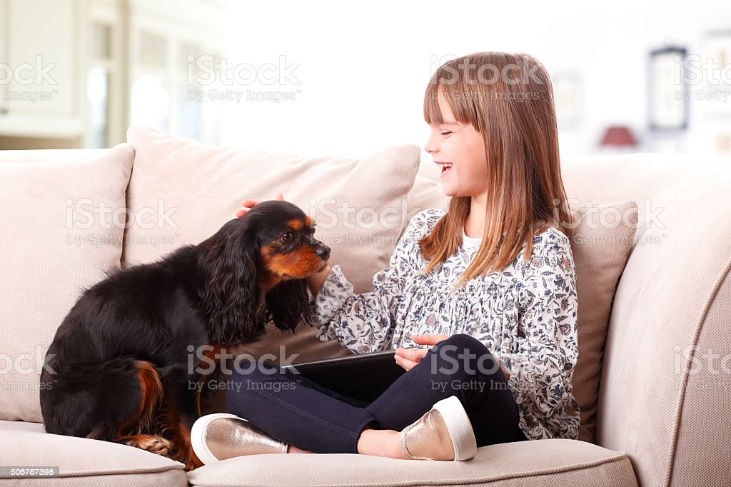 Little girl and her puppy stock photo