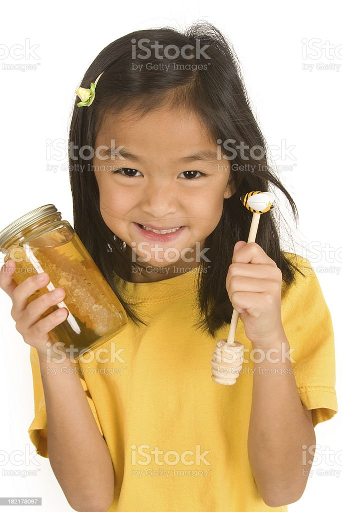 Little girl and honey series royalty-free stock photo