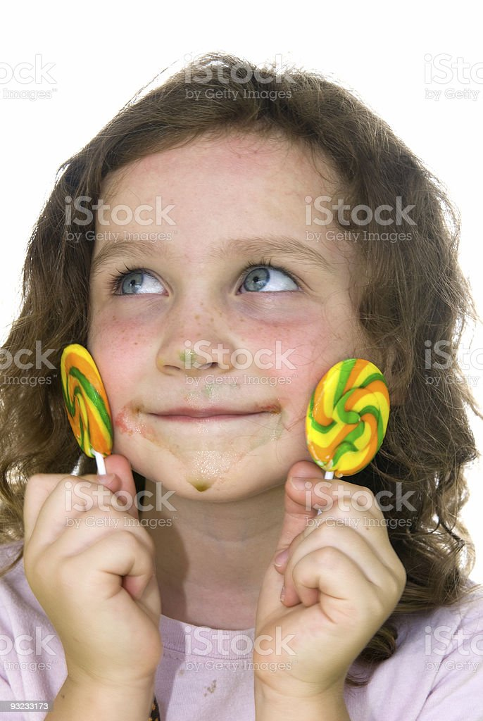 Little girl and lollipops royalty-free stock photo