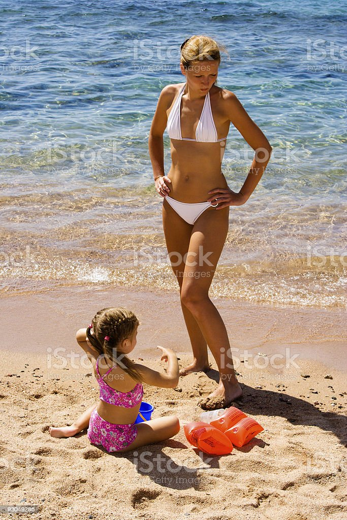 Little girl and mom on beach royalty-free stock photo