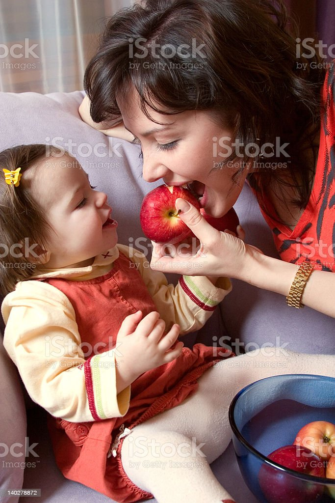 little girl and mother with apples royalty-free stock photo
