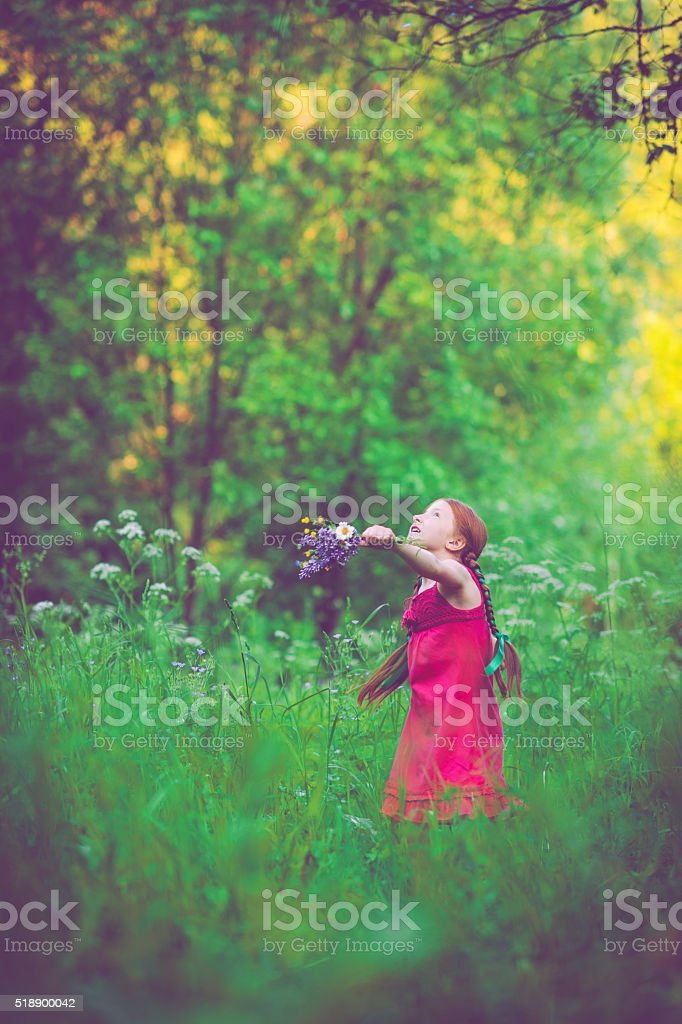 Little girl and nature stock photo