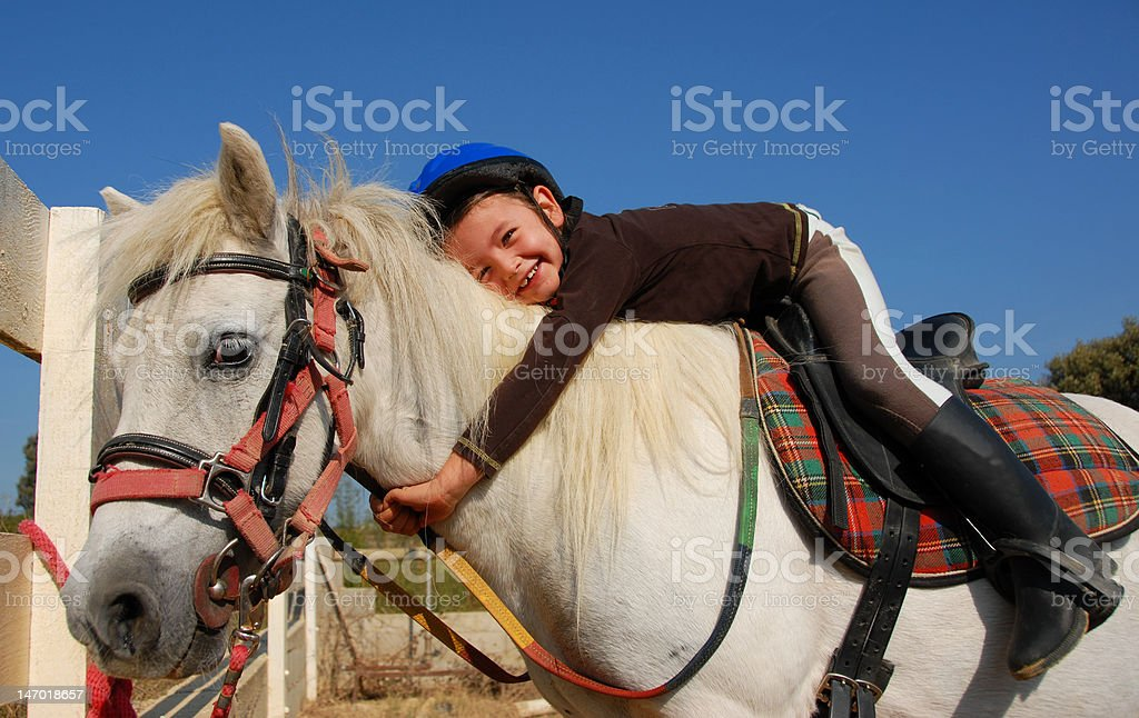 little girl and shetland pony stock photo