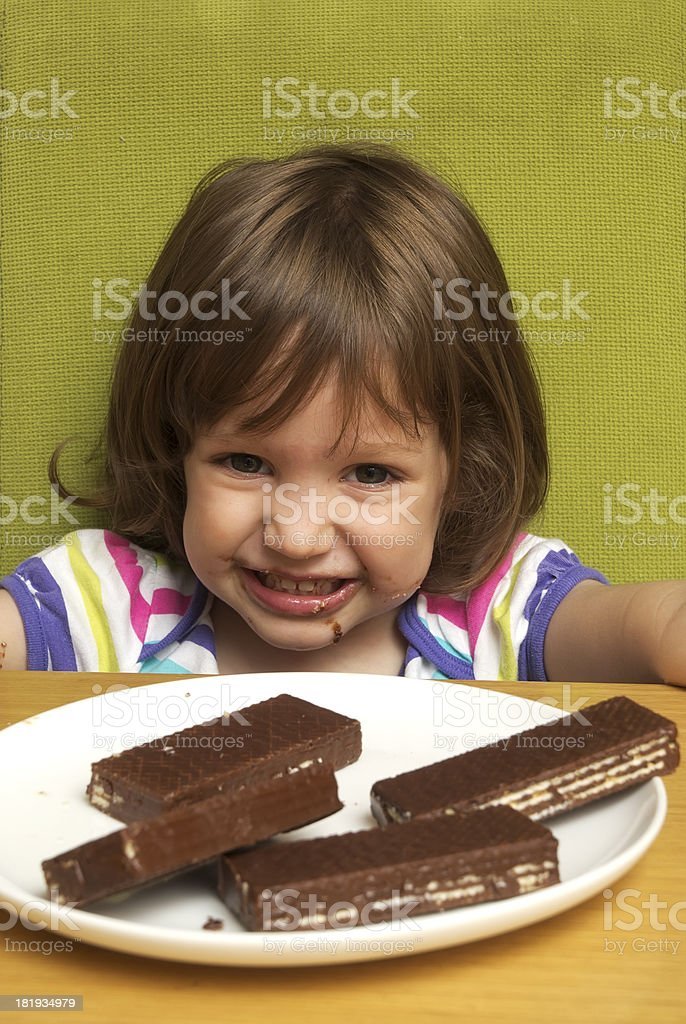 Little girl and sweets stock photo
