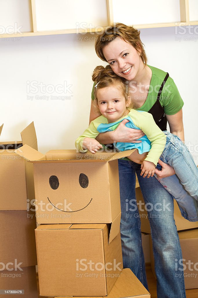 Little girl and woman with cardboard boxes royalty-free stock photo