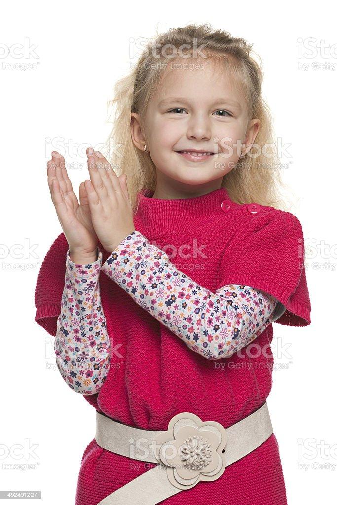 Little girl applauds royalty-free stock photo