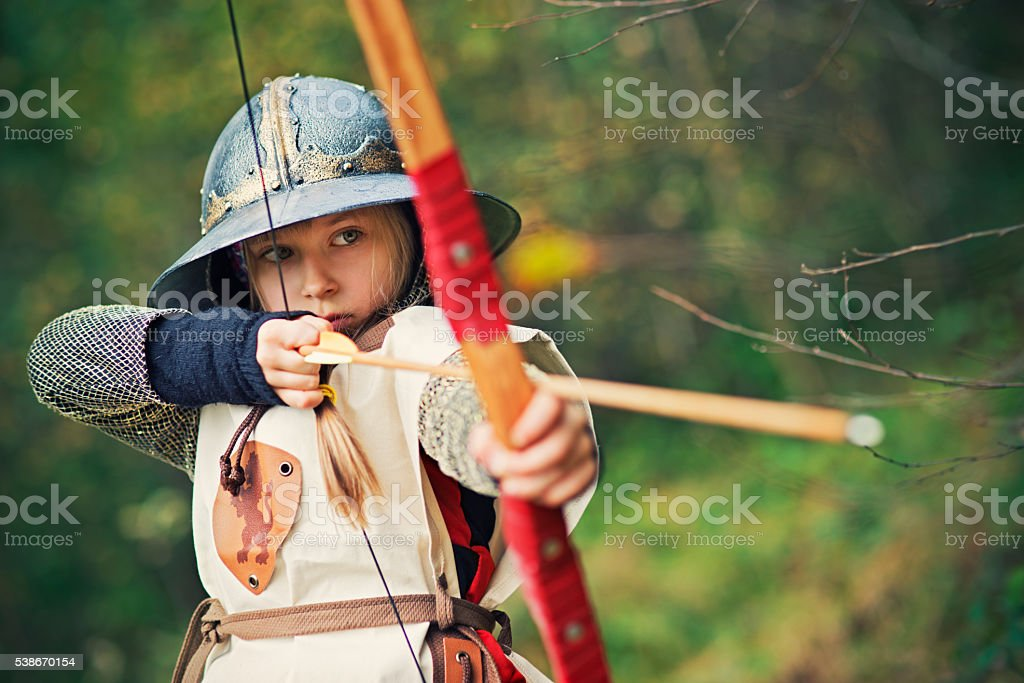Little girl archer aiming stock photo