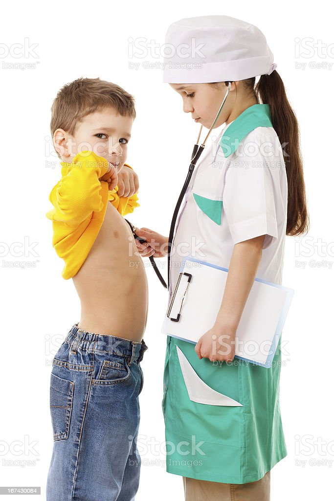 Little girl as doctor are listening a boy royalty-free stock photo