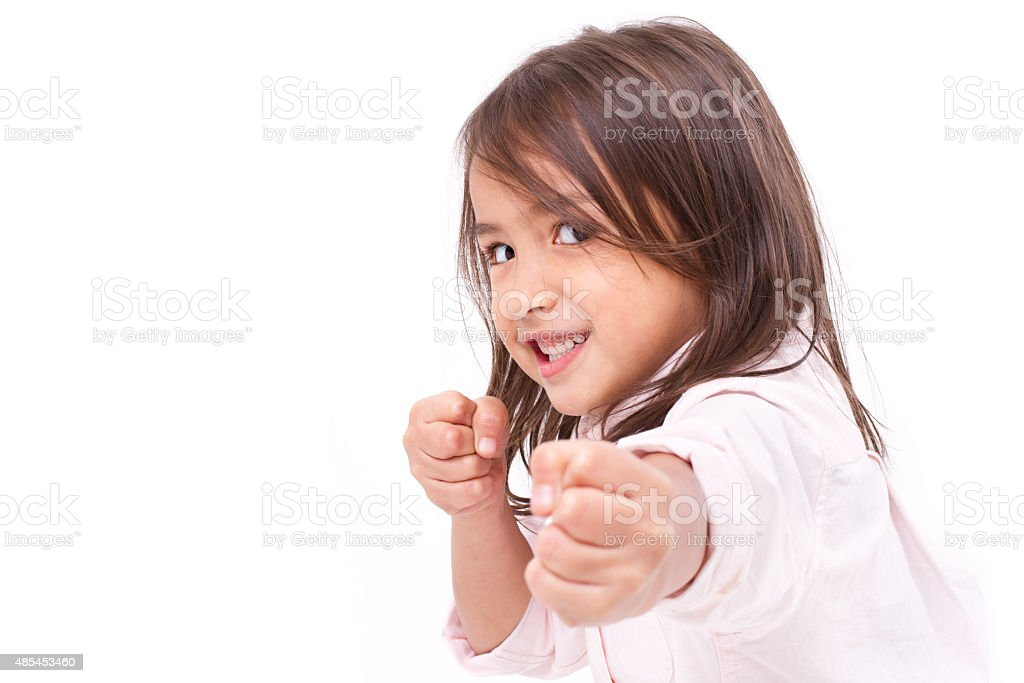 little girl assuming stance, practicing martial arts, self-defen stock photo